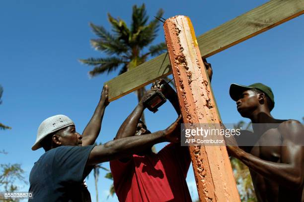 People rebuilds a destroyed business in the aftermath of Hurricane Maria in Loiza Puerto Rico September 28 2017 The US island territory working...