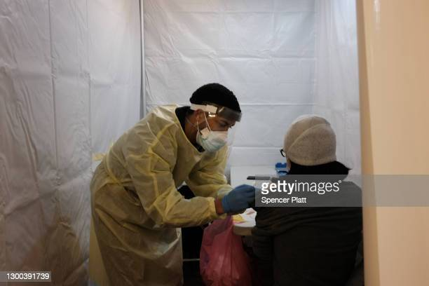 People receive a COVID-19 vaccination shot at a pop-up vaccination site at a Bronx church on February 04, 2021 in New York City. After a snowstorm...