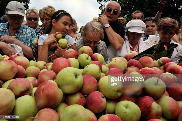 People receive free apples during the Transfiguration of Jesus holiday also known as Yablochny Spas outside an Orthodox cathedral in Russia's second...