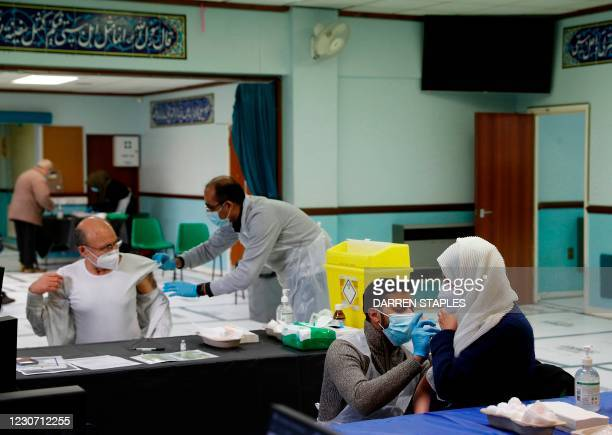 People receive the Oxford/AstraZeneca Covid-19 vaccine at the Al-Abbas Islamic Centre, which has been converted into a temporary vaccination centre...