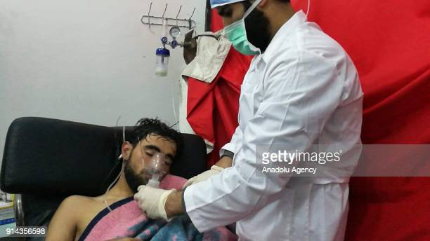 People receive treatment at a hospital after alleged chlorine gas attack by Assad regime forces to Saraqib district of Idlib Syria on February 04 2018