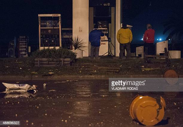 People recover their belongings after a large earthquake in Concon some 110 kms northwest of Santiago on September 16 2015 The 83magnitude earthquake...