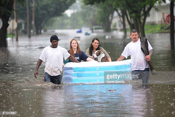 People recover their dogs from flooded and evacuated homes on June 12, 2008 in Cedar Rapids, Iowa. Much of the city has been evacuated as the Cedar...