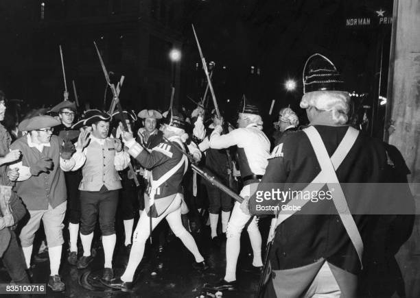 People reenact the Boston Massacre at the rear of the Old State House in Boston, March 5, 1970.