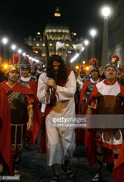 People reenact the way of the cross by Jesus Christ on Via della Conciliazione leading from St.Peter's Basilica at the Vaticano in Rome on February...