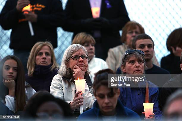 People reflect during a candlelight vigil attended by hundreds at Jonathan Law High School after the death of Maren Sanchez who was stabbed to death...