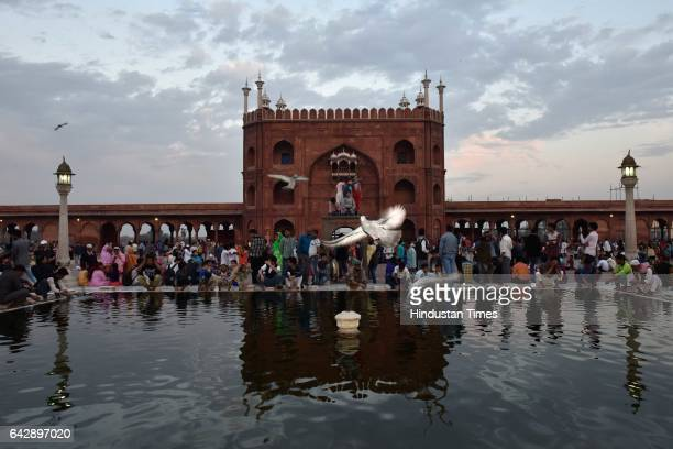 People rejoicing pleasant weather as clouds cover the skyline of the capital at Jama Masjid on February 19 2017 in New Delhi India