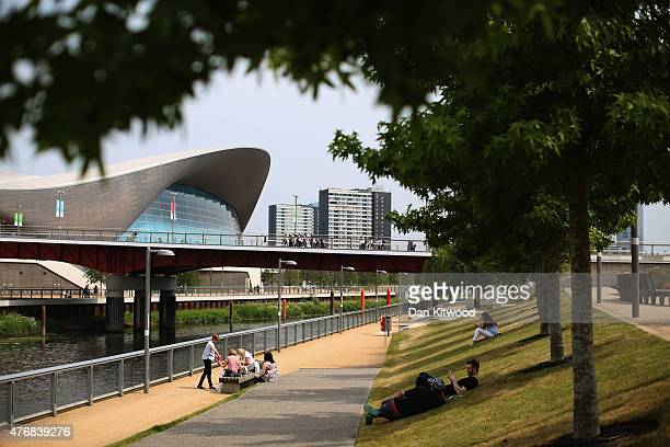 People relax along the canal at Olympic Park on June 12 2015 in London England The MET Office predicted that parts of the country would enjoy the...