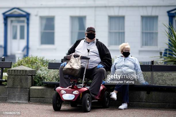 People relax and enjoy Llandudno promenade after pandemic travel restrictions were eased on July 06, 2020 in Llandudno, United Kingdom. Lockdown...