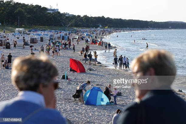 People relax at a beach on the Baltic Sea coast on Rügen Island on August 04, 2021 in Binz, Germany. Holiday destinations along Germany's Baltic Sea...