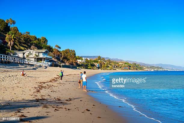People Relax at Paradise Cove Beach in Malibu California USA