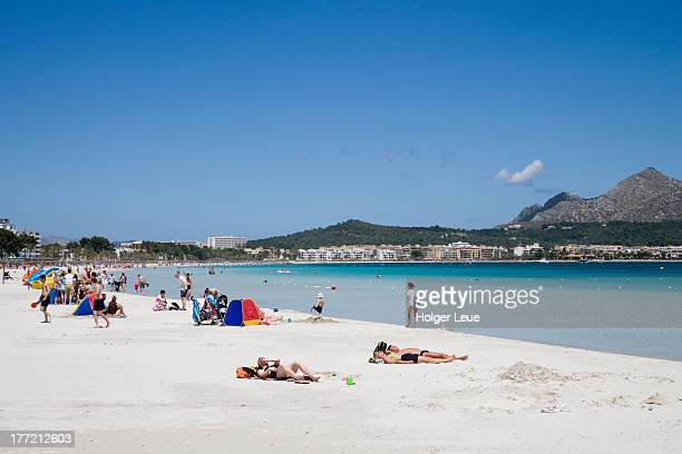 People relax at Port d'Alcudia beach