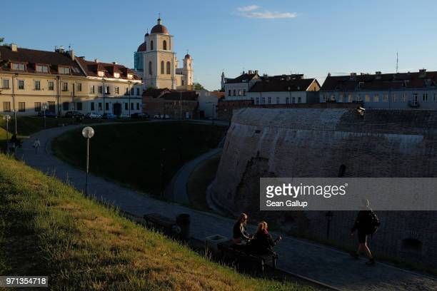 People relax at the 16thcentury Bastion of Vilnius City Wall on June 6 2018 in Vilnius Lithuania Vilnius is the capital of Lithuania and a popular...