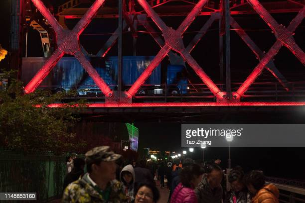 People relax at Yalu river park on April 29, 2019 in Dandong, China.The leader of the Democratic People's Republic of Korea , Kim Jong Un, has called...