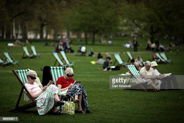 People relax in deck chairs in St James's park on April 27 2010 in London England The Met office are forecasting more sunny spells to come that could...