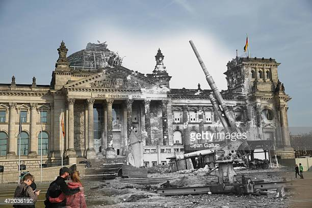 In this digital composite image a comparison has been made showing a German artillery gun standing in front of the ruins of the Reichstag after World...
