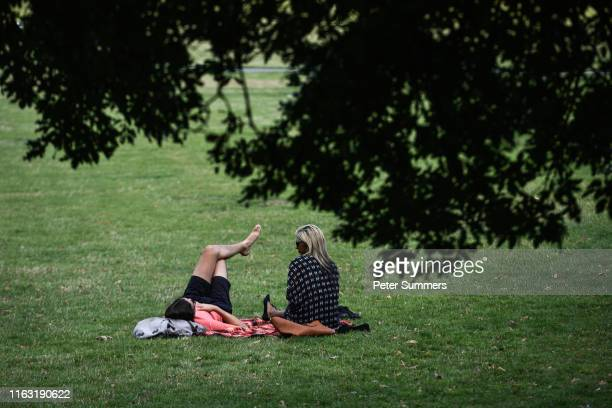 People relax in Greenwich park on a sunny day on August 22 2019 in London England Weather forecasters are predicting that the UK could have record...
