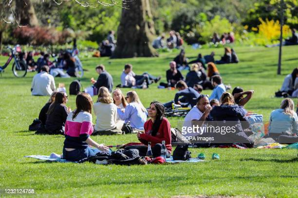 People relax in St James' Park as Londoner's take advantage of sunny weather on Easter Sunday.