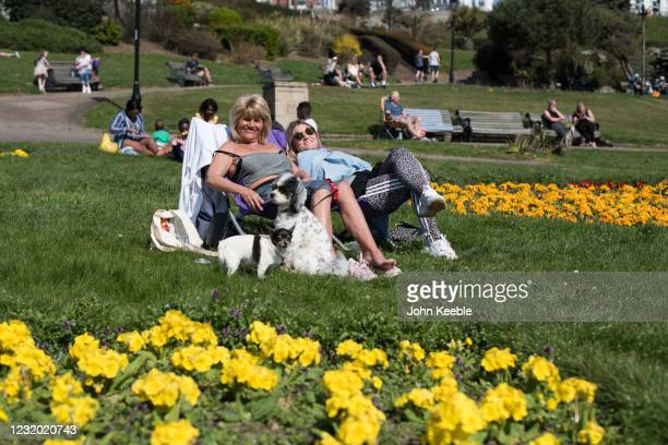 People relax in the sun in Cliff Gardens in Westcliff on March 30, 2021 in Southend, United Kingdom. Despite todays temperature heading towards 24...