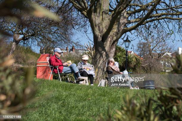 People relax in the sun with a picnic in Cliff Gardens in Westcliff on March 30, 2021 in Southend, United Kingdom. Despite todays temperature heading...