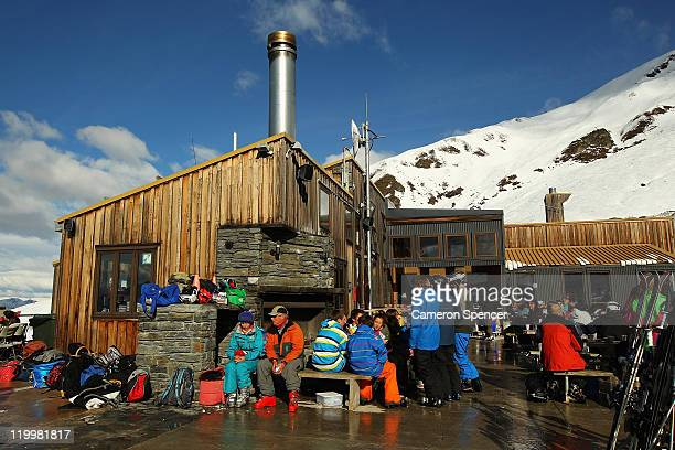 People relax on a verandah at the base lodge at Treble Cone ski resort on July 28 2011 in Wanaka New Zealand