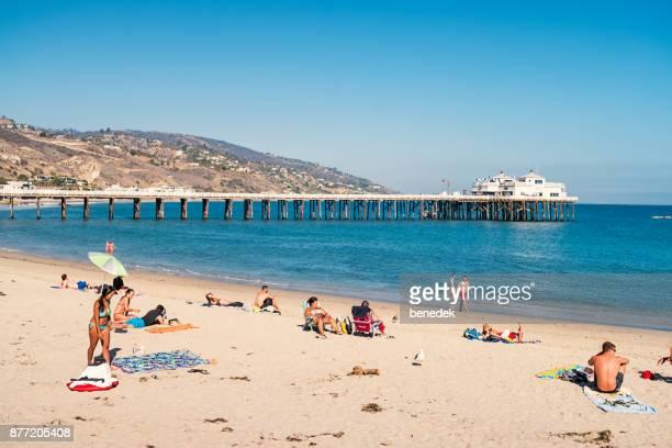 b3cf729b8f0cad People relax on beach in Malibu California USA