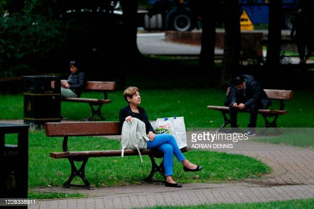 People relax on benches in The Maltings shopping centre in Salisbury, southern England on September 4, 2020 which was the scene of the nerve agent...