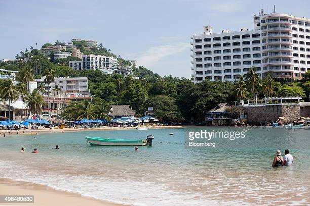 People relax on Caleta Beach in Acapulco Mexico on Wednesday Nov 18 2015 Acapulco needs to shed the perception that it is a 'place of violence' and...