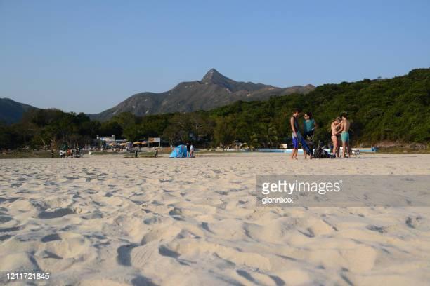 ハムティンビーチ、シクンイーストカントリーパーク、香港でリラックスする人々 - ジオパーク ストックフォトと画像