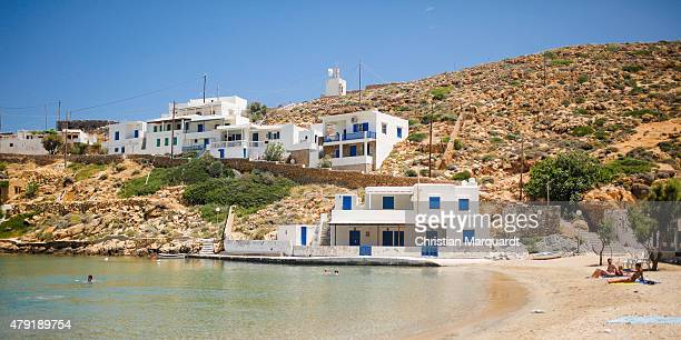 People relax on the beach at the port of Cheronissos during midday on June 18 2015 in Sifnos Greece Sifnos is a island in the western Aegean Sea the...