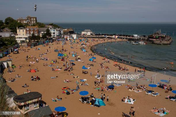 People relax on the beach at Viking Bay on June 26, 2020 in Broadstairs, Kent, England. The UK is experiencing a summer heatwave, with temperatures...
