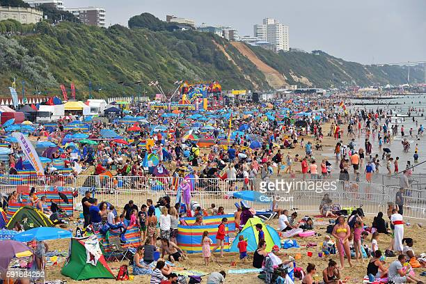 People relax on the beach during the Bournemouth Air Festival on August 18 2016 in Bournemouth England The air show runs from the 18th to 21st August...