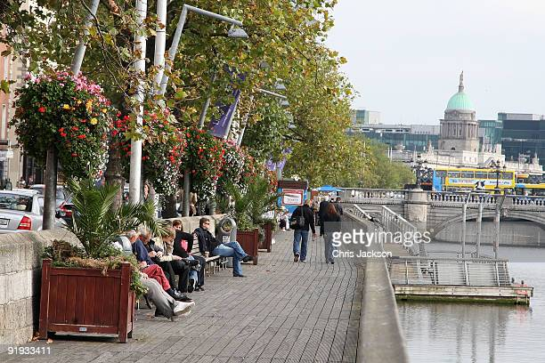 People relax on the river front on October 15 2009 in Dublin Ireland Dublin is Ireland's capital city located near the midpoint of Ireland's east...