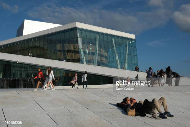 People relax outside the Oslo Opera House during the novel coronavirus pandemic on July 27, 2020 in Oslo, Norway. Norway has fared comparatively well...
