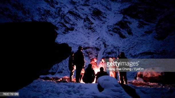 people relaxing at campsite during winter - kashmir stock photos and pictures