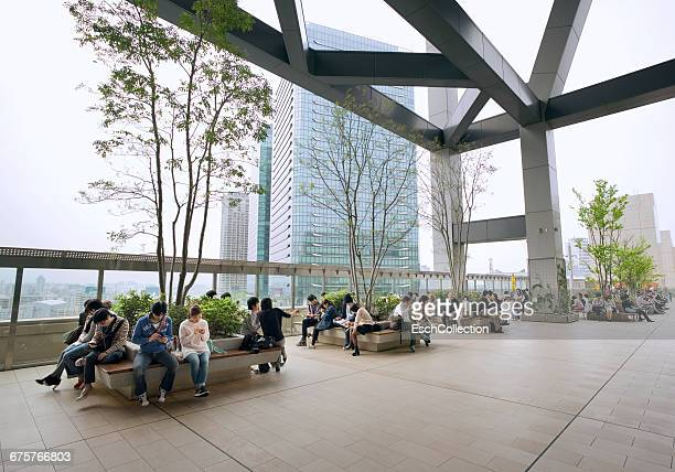 People relaxing at rooftop park of Osaka Station