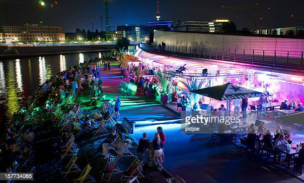 people relaxing at strand bar near Spree river Berlin Germany