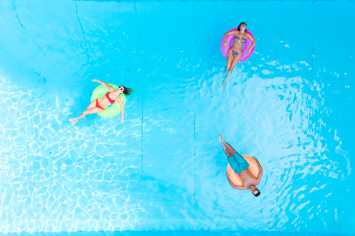 People relaxing at swimming pool - gettyimageskorea