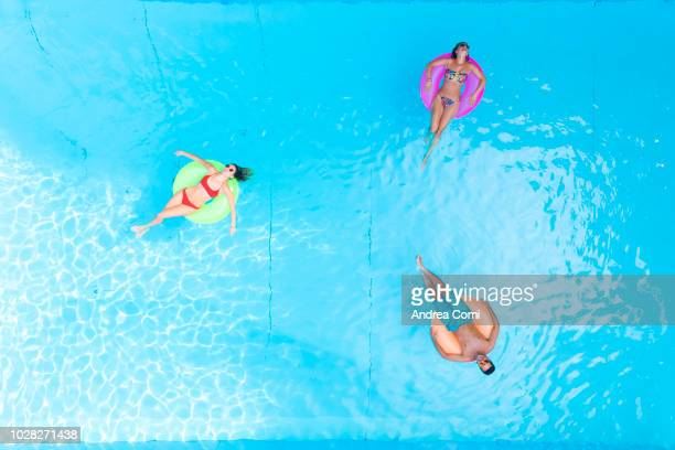 people relaxing at swimming pool - standing water stock pictures, royalty-free photos & images