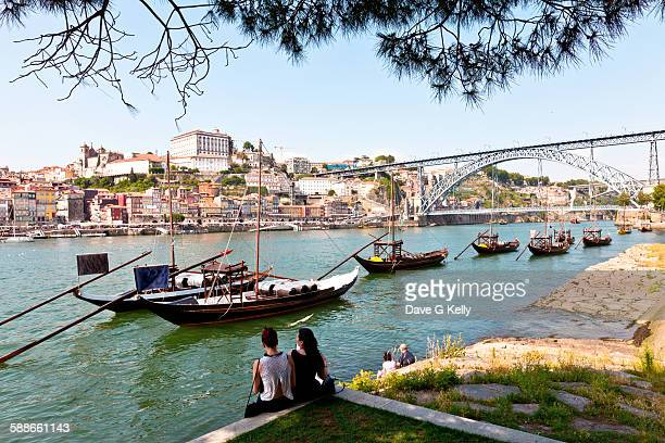 People relaxing at the Douro riverbank