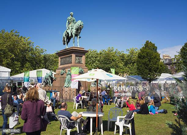 people relaxing at the edinburgh international book festival - literature stock photos and pictures