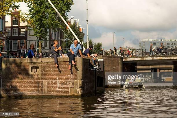 people relaxing at the eenhoornsluis - merten snijders stock pictures, royalty-free photos & images