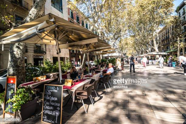 people relaxing in a cafe, barcelona, spain - tapas stock photos and pictures