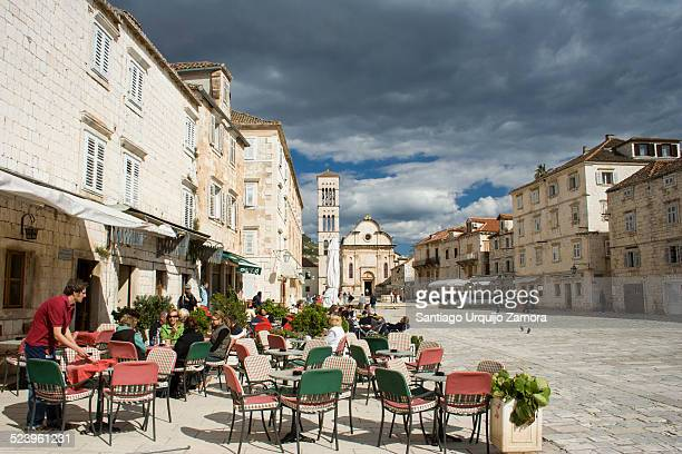 People relaxing in a sidewalk cafe on a sunny day in the town of Stari Grad Hvar Island SplitDalmatia County Croatia Europe