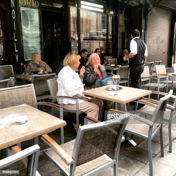 People relaxing in Brussels cafe, Belgium