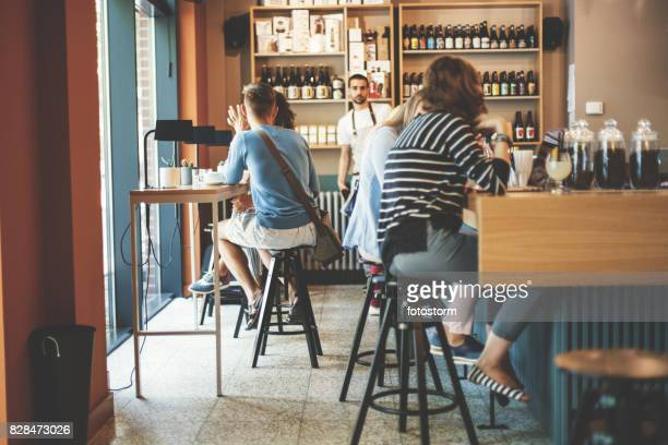 People relaxing in cafe bar