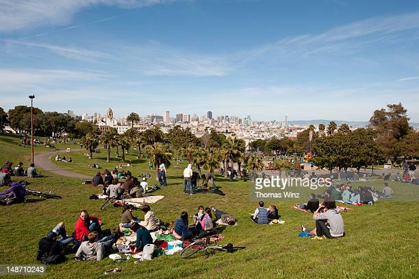 People relaxing in Dolores Park.