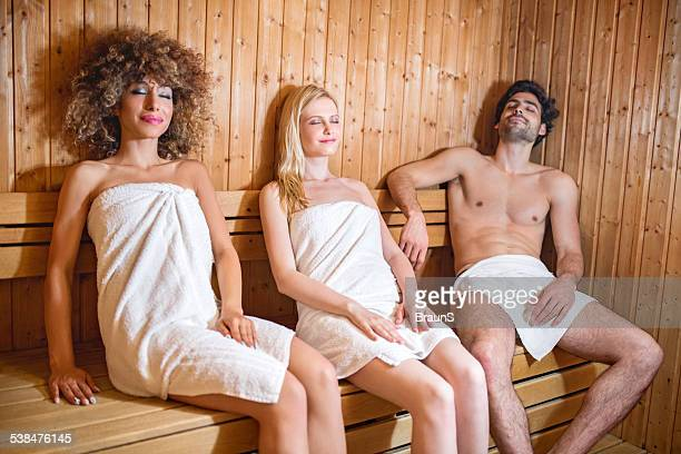 people relaxing in sauna. - black woman in sauna stock pictures, royalty-free photos & images