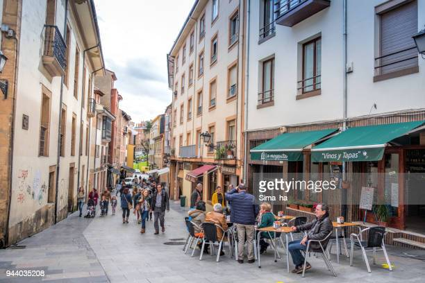 people relaxing in the bar in the old city of oviedo, spain - oviedo stock pictures, royalty-free photos & images