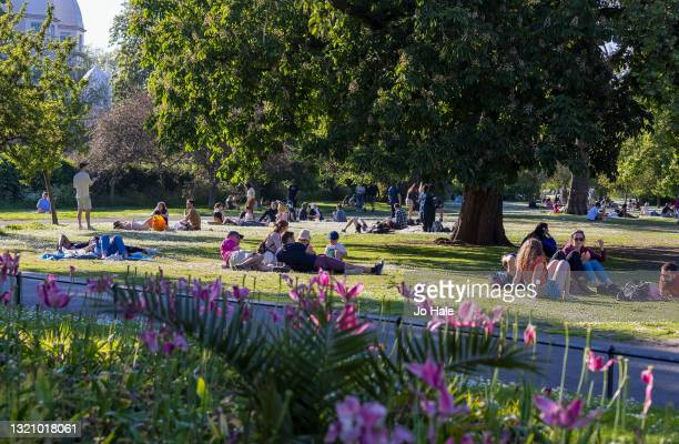 People relaxing in the sun in Regents Park on May 31, 2021 in London, England.